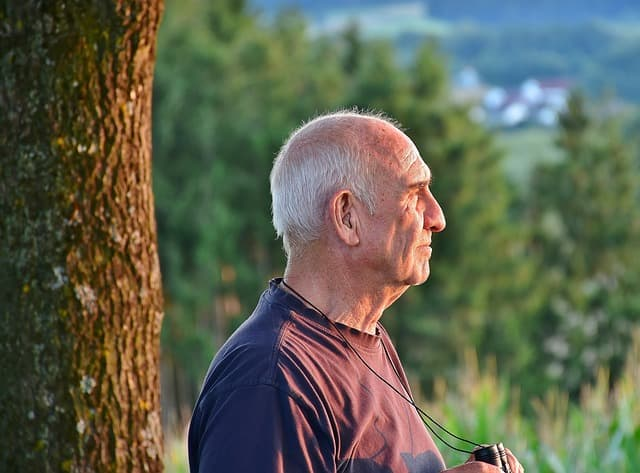 picture of an elderly man looking into the horizon