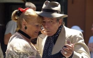 An older couple dancing as a good example of physical exercise.