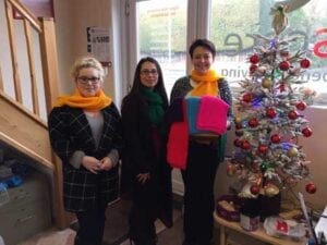 Care at home service user knitted these scarves for charity