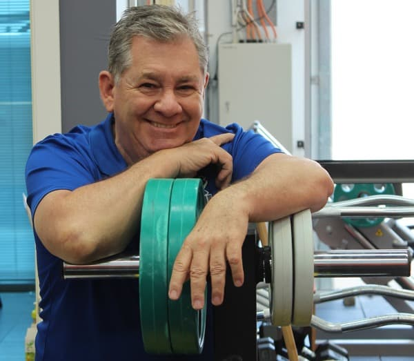 old man weights fitness smiling
