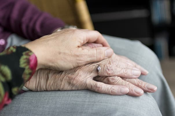 Hands showing elderly companionship suggesting importance